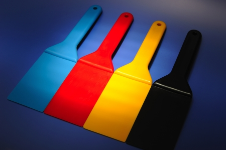 horozontal: Spatulas to spread the ink used in offset printing Stock Photo