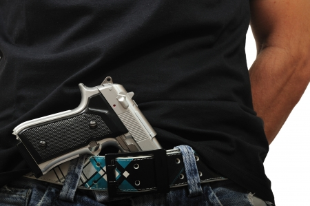 man with gun: Man with gun tucked into the waistband of his trousers Stock Photo