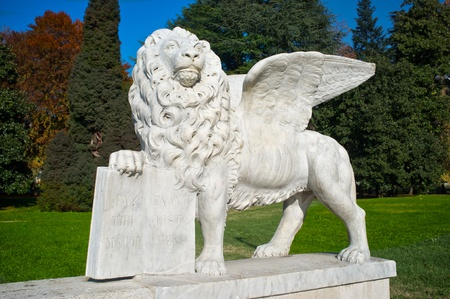 evangelist: statue of the lion of San Marco in a park