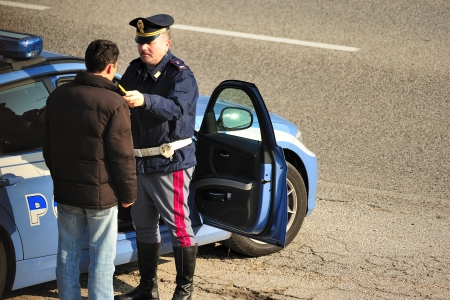 stopped: Vicenza, Northern Italy, Italy - October, 29, 2011: Italian police make an alcohol test to a motorist stopped for a control