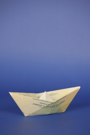 clandestine: Italian residence permit for foreigners, shaped like a paper boat