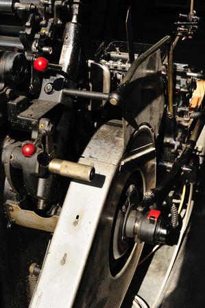 printery: detail of an old printing press machine