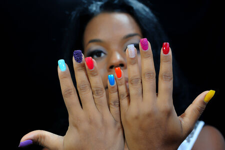 american sexy: mulatto girl with colorful fingernails Stock Photo