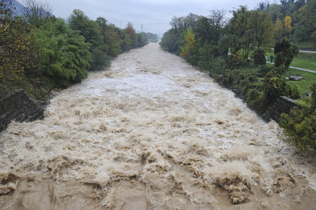 threatens: river rises and  threatens flooding Stock Photo