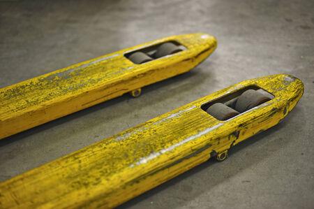 closeup of yellow pallet trucks photo
