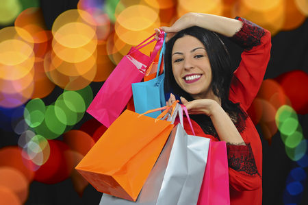 promotion girl: shopping girl in the city colored night light Stock Photo
