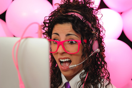 mouthed: young girl with pink glasses talking on the computer