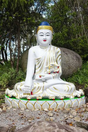 colored statue of Buddha in the earth touching position 版權商用圖片