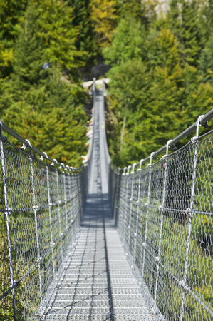 entrance of suspension metal bridge in Valli del Pasubio, Italy 版權商用圖片