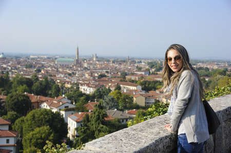 Tourist girl enjoying view of beautiful panorama of Vicenza (Italy)