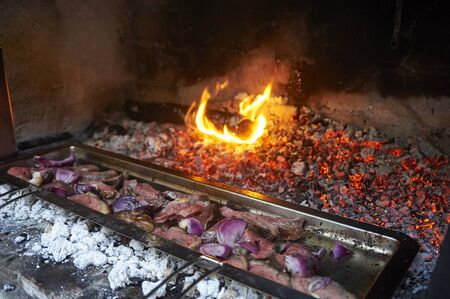 grilled meat in an old barbecue, cooking over solid-fuels