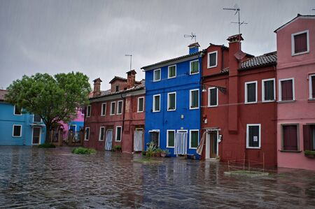 colorful houses on the island of Burano during a thunderstorm