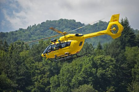 16/07/2019 Valdagno (VI) Italy: yellow Italian rescue helicopter in flight