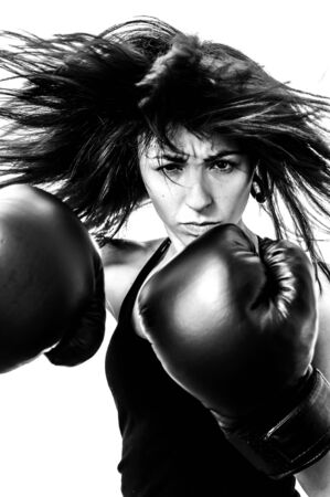 girl with boxing gloves in defiant pose