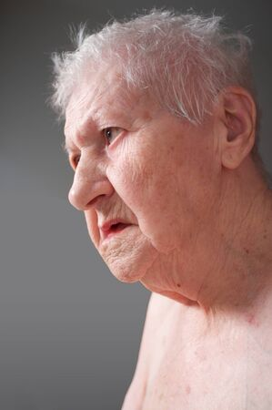 portrait of sad lonely pensive old senior woman