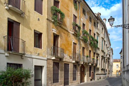 ancient Italian apartments with balconies and protections against pigeons 版權商用圖片