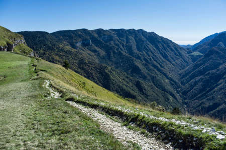 hiking trail in the Italian mountain. The Folgaria high Italian plateau for trekking and relaxation