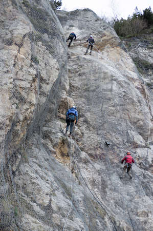 7/11/2020 Campobrun nature reserve, Trentino, Italy: installation of active rockfall barrier system is covering the mountain to prevent stones from falling down 新闻类图片