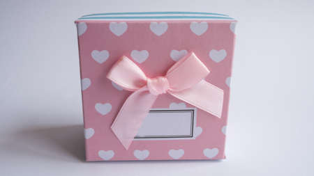 Multicolored gift box with a pink bow. Empty gift boxes on white background with shadow, isolated.