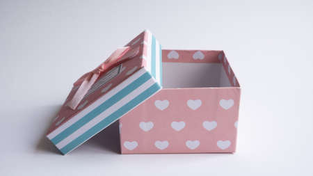 A multi-colored gift box with an open lid. Empty gift boxes on white background with shadow, isolated. Zdjęcie Seryjne