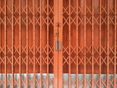metal: Orange rusty sliding metal door background