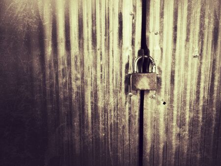 rough: Metal door with lock in grungy style.