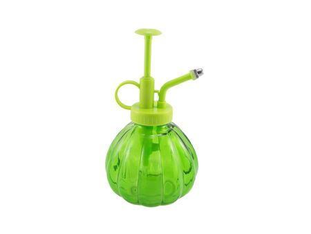 isolated: Green glass spray bottle isolated on white .