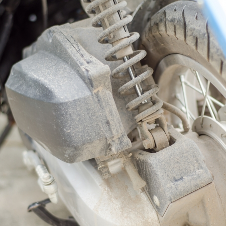 dirty shock absorber part of motorbike photo