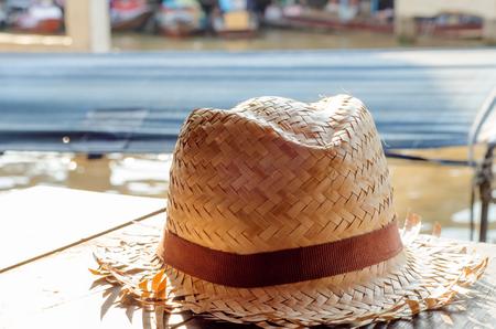 pokrývka hlavy: hat, headgear on the table against soft light