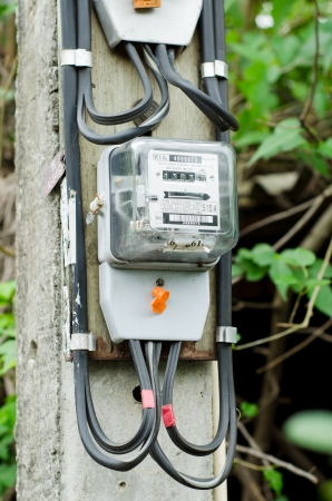 electricity meter: electricity meter on column Stock Photo
