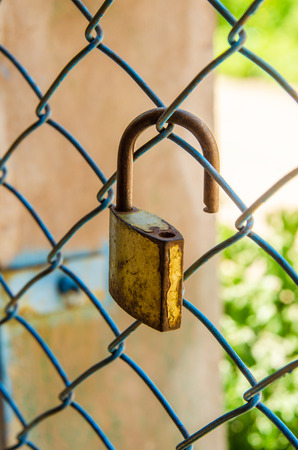 old padlock on the metal cage photo
