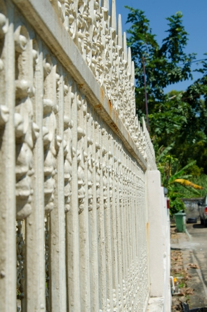 backstop: white fencing home border, shallow depth of field Stock Photo