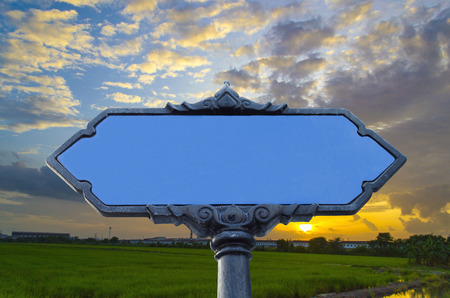 blank road sign against blue sky background Stock Photo