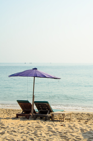 Chairs and umbrella on a beautiful tropical beach. photo