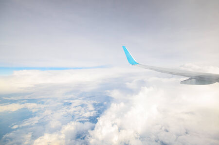 int: Clouds and sky seen through window of an aircraft Stock Photo