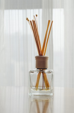 glass sphere: Aroma bottle glass and wooden sticks on the table