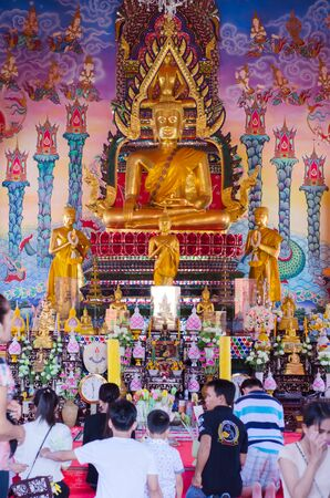 ble: BANGKOK, THAILAND - June 1: People and holy Buddhist statue at a temple during a merit making ceremony to make the traditional worship on June 1, 2015 in Bangkok, Thailand. Editorial