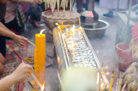 architectural tradition: Hand of people and light candles to pay homage to the sacred. Stock Photo