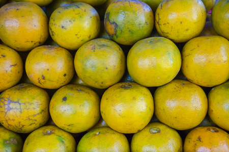 citrus reticulata: Close up focus a lots of orange on stack at market place,(Citrus reticulata, Tangerine)