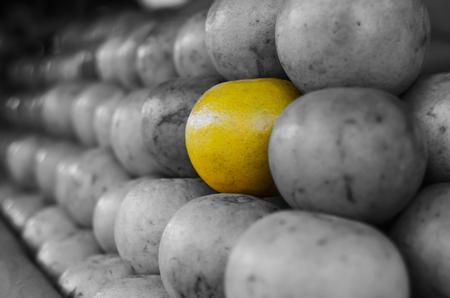 citrus reticulata: Depth of field close up focus on one orange in stack at market place,(Citrus reticulata, Tangerine) Stock Photo