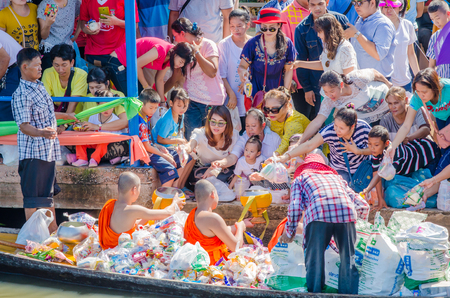 yearly: BANGKOK,THAILAND-November 1,2015 : Thai people offerings to a Buddhist monks on Ok Phansa day(End of Buddhist Lent) in Ladkrabang, Bangkok,Thailand.