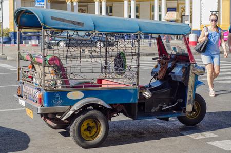 tuktuk: BANGKOK, THAILAND - December 31, 2015 : Tuk-Tuk stop on road, Samlors or three wheeled bikes that should not be missed in Bangkok trip.