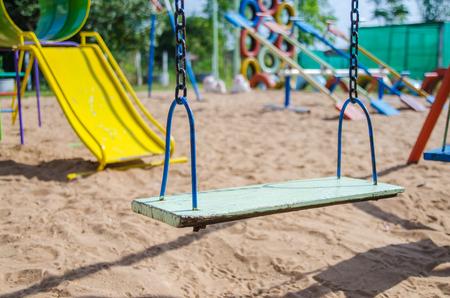 swing seat: Empty swing set in playground, blank swing seat.