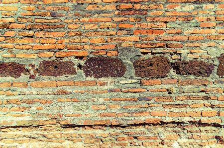 Background of red brick wall texture in retro style Stock Photo