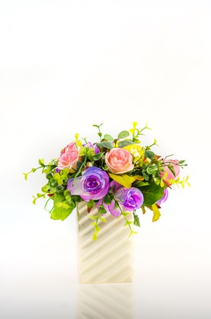 Artificial Rose Flowers In Vase On White Backgrounds Stock Photo