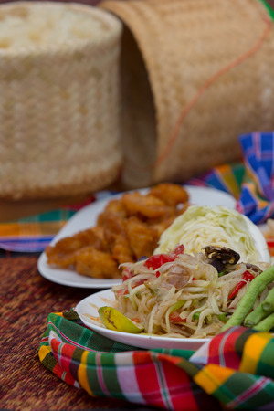 Thai papaya salad serve with vegetables close up  photo