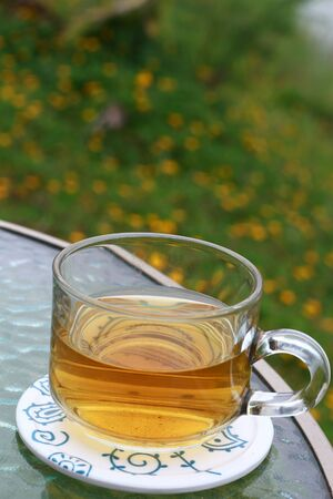 Glass of tea on the table  photo