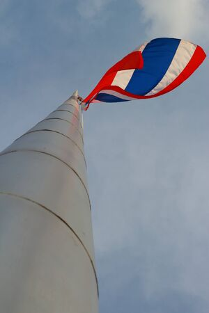 Thailand flag on a pole high in the sky  photo