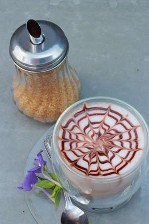 Latte art pour sugar  With purple flowers  photo