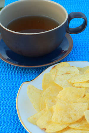 Cornflakes with hot tea, blue table  photo